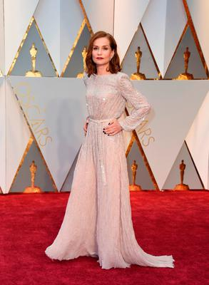 "Nominee for Best Actress ""Elle"" Isabelle Huppert arrives on the red carpet for the 89th Oscars on February 26, 2017 in Hollywood, California.  / AFP PHOTO / VALERIE MACONVALERIE MACON/AFP/Getty Images"