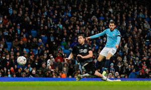 Manchester City's Bernardo Silva scores their second goal. Photo: Phil Noble/Reuters