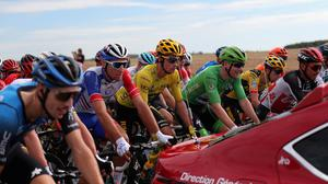 Sam Bennett wearing the best sprinter's green jersey follows the race director's car at the start of the stage 12. Photo: AP
