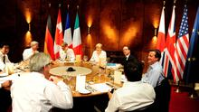 Japanese Prime Minister Shinzo Abe, Canada's Prime Minister Stephen Harper, US President Barack Obama, Germany's Chancellor Angela Merkel, French President Francois Hollande, British Prime Minister David Cameron and Italy's Prime Minister Matteo Renzi attend a working dinner at the G7 summit in Elmau Castle near Garmisch-Partenkirchen, southern Germany