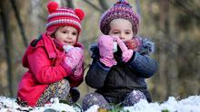 Cool fun: Sisters Ella (3) and Lola Reid (4), from Knocklyon, enjoy the snow in the Dublin Mountains. Photo: Steve Humphreys