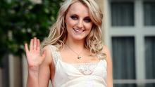 Evanna Lynch arrives for the world premiere of Harry Potter And The Deathly Hallows in London in 2011.