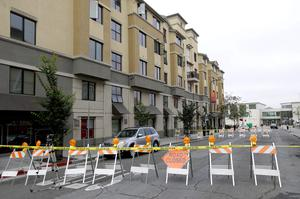 Police tape blocks off a section of Kittredge Street in front the Library Gardens apartment building where balcony collapsed in Berkeley, California (AP Photo/Jeff Chiu)