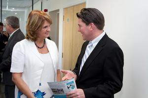 Joan Burton talks with Rory Finegan from Finegan Chartered Accountants, Baggot Street, who was a Momentum Programme participant. Picture Colm Mahady / Fennells - Copyright 2014 Fennell Photography