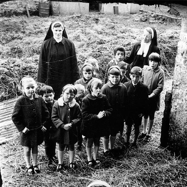 Sr Kevin (back left) with pupils from the school