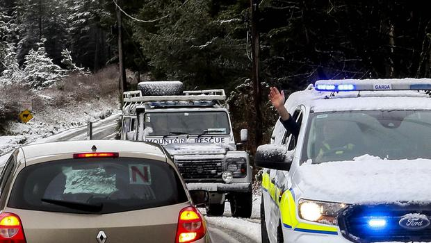 Risk: Gardaí and mountain rescue 4x4s return from the Sally Gap in Co Wicklow with snow tourists on board they had rescued as conditions continued to deteriorate. Photo: Garry O'Neill