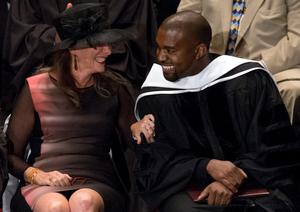Musician Kanye West (R) is congratulated by Lisa Wainwright after receiving an honorary doctorate degree from the School of the Art Institute of Chicago in Chicago, Illinois May 11, 2015. REUTERS/Jim Young