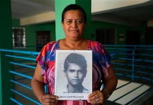 Doris Yamilet Mesa Zabala holds a picture of her missing brother Marvin Leonel. Photo: Frank McGrath