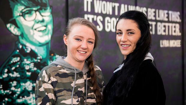 Robyn Peoples and Sharni Edwards, who are poised to become the first couple to have a same-sex marriage in Northern Ireland, at the Lyra McKee mural in Belfast. Photo Liam McBurney/PA Wire