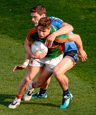 Lee Keegan and  Diarmuid Connolly battle it out in the semi-final of 2015.