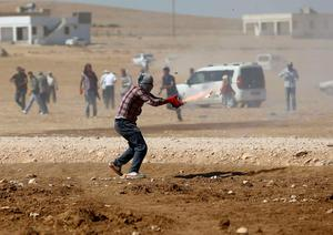 Turkish Kurdish protesters clash with Turkish security forces during a pro-Kurdish demonstration near the southeastern town of Suruc in Sanliurfa province. Reuters