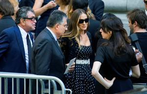 Sarah Jessica Parker, center right, speaks with attendees after a funeral service for comedian Joan Rivers at Temple Emanu-El in New York Sunday, Sept. 7, 2014. Rivers died Thursday at 81. (AP Photo/Craig Ruttle)