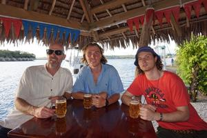 Brian Stynes enjoying a drink with his sons Jamie and Sammy at a bar in Melbourne that he has a share in.