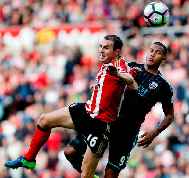 Sunderland defender John O'Shea contests an aerial ball with West Brom's Salomon Rondon. Photo: Russell Cheyne/Reuters