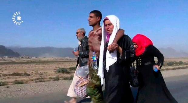 This image made from video by Rudaw News Agency shows a family fleeing Mosul, Iraq on Tuesday, Oct. 18, 2016. Photo: Rudaw News Agency via AP