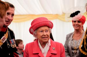 RICHMOND, ENGLAND - MAY 02:  Queen Elizabeth II speaks to soldiers and their families following the amalgamation parade of The Queen's Royal Lancers and 9th/12th lancers (Prince of Wales's) at Richmond Castle on May 2, 2015 in Richmond, England. The Queen took the Royal Salute in the historic castle grounds before inspecting and addressing the parade of the newly formed The Royal Lancers before the Regiment marched past the saluting dias.  (Photo by Ian Forsyth/Getty Images)