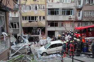 Forensic officers and firefighters work at the scene of a gas blast in Istanbul