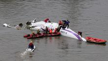 Rescuers carry out a rescue operation after a TransAsia Airways plane crash landed in a river, in New Taipei City. Reuters/Stringer