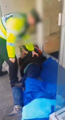 A garda is seen in the video with his foot apparently on the handcuffed man's leg