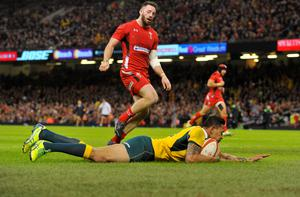 Australia's Israel Folau scores a try against Wales during their Autumn International rugby union match at the Millennium Stadium in Cardiff, Wales, November 8, 2014. REUTERS/Rebecca Naden (BRITAIN - Tags: SPORT RUGBY)