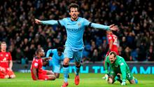 David Silva celebrates after scoring Manchester City's opening goal in their Premier League clash with Leicester City at the Etihad. Photo: Alex Livesey/Getty Images