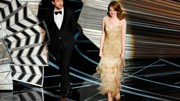 Actors Ryan Gosling (L) and Emma Stone walk onstage during the 89th Annual Academy Awards at Hollywood & Highland Center on February 26, 2017 in Hollywood, California.  (Photo by Kevin Winter/Getty Images)