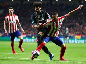 Liverpool's Mohamed Salah battles for possession with Atletico Madrid's Renan Lodi. Photo: Reuters