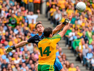 BATTLE: Dublin's Stephen Cluxton and Donegal's Michael Murphy contest a high delivery during the 2014 All-Ireland semi-final. Pics: Sportsfile
