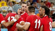 Wales' Jonathan Davies celebrates scoring their first try with team mates