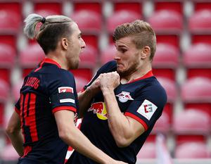 RB Leipzig's Timo Werner celebrates scoring their fourth goal with Kevin Kampl, as play resumes behind closed doors following the outbreak of the coronavirus disease REUTERS/Kai Pfaffenbach/Pool