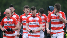 Cork Institute of Technology players and coaching staff leave the field dejected Photo by Sam Barnes/Sportsfile