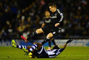 Youssuf Mulumbu of West Brom tackles Fernando Torres of Chelsea