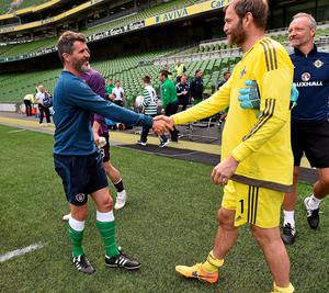Roy Keane, Republic of Ireland  assistant manager, shakes hands with Northern Ireland goalkeeper Roy Carroll at the end of the game