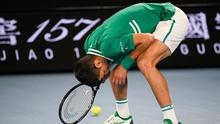 Serbia's Novak Djokovic reacts during his third round match against United States' Talyor Fritz at the Australian Open tennis championship in Melbourne, Australia, Friday, Feb. 12, 2021. (AP Photo/Andy Brownbill)