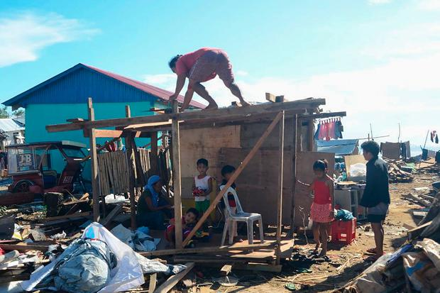 Residents construct a makeshift shelter after their house was destroyed at the height of Typhoon Phanfone in Guiuan town in Eastern Samar province on December 26, 2019. (Photo by ALREN BERONIO/AFP via Getty Images)