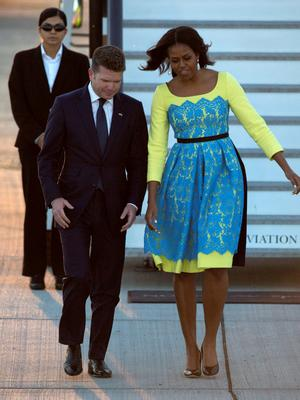 U.S. first lady Michelle Obama greets U.S. Ambassador to Britain Matthew Barzun (L) at Stansted Airport, southern England June 15, 2015. REUTERS/Neil Hall