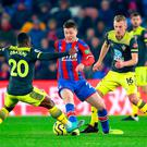 Crystal Palace's James McCarthy (centre) battles for the ball against Southampton's Michael Obafemi (left) and James Ward-Prowse during the Premier League match at Selhurst Park. Photo credit: Nigel French/PA Wire.