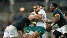 Simon Zebo, Ireland, is tackled by Bismarck du Plessis, South Africa at the Guinness Series, Ireland v South Africa match (Ramsey Cardy / SPORTSFILE)