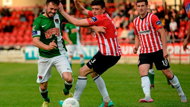 26 June 2015; Ross Gaynor, Cork City, in action against Dean Jarvis, Derry City. SSE Airtricity League Premier Division, Derry City v Cork City, Brandywell, Derry. Picture credit: Oliver McVeigh / SPORTSFILE