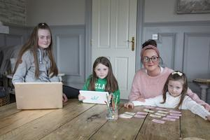 13/3/20 Amy McArdle with her daughters Eve age 11 in 6th class, Lucia, 9, 3rd class and Esme, 5 in junior infants, who are keeping up with lessons from their school in Faughart, Co Louth via in internet. Picture: Arthur Carron.