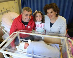 Clare Lynch and Pero Pejoski with their daughter Nina Lynch Pejoska and their new baby, who was born at 12.59am in the Rotunda Hospital