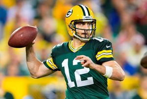 Green Bay Packers quarterback Aaron Rodgers (12) throws a pass during the fourth quarter against the Kansas City Chiefs at Lambeau Field.  Green Bay won 38-28. Credit: Jeff Hanisch-USA TODAY Sports