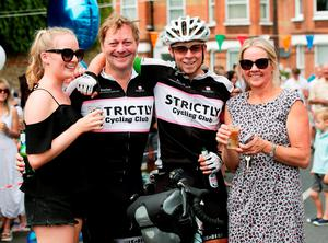 Tom Davies, 19, who claims to be the youngest person to have cycled around the world,  has a toast to celebrate with his sister Anna (left), dad Huw and mother Alison after arriving back in London to his home in Battersea, on the final leg of his epic 18,000-mile journey. PRESS ASSOCIATION Photo. Picture date: Sunday August 9, 2015. Battling wind, rain and snow, he has notched up 100 miles of cycling a day to complete his trip, and raised nearly ?50,000 for charities. See PA story CHARITY Cyclist. Photo credit should read: Yui Mok/PA Wire