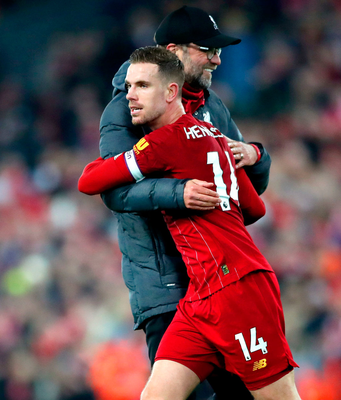 Liverpool's Jordan Henderson celebrates with manager Jurgen Klopp after the Premier League win over Wolves at Anfield. Photo: PA