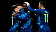 Danny Welbeck celebrates with his Arsenal teammates Hector Bellerin and Mesut Oezil after scoring the winning goal in the FA Cup quarter-final against Manchester United at Old Trafford. Photo: Laurence Griffiths/Getty Images
