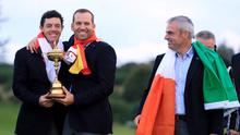 Europe's Rory McIlroy (left) and Sergio Garcia with the Ryder cup trophy as Paul McGinley looks on during day three of the 40th Ryder Cup at Gleneagles