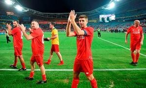 Former Liverpool football stars Steven Gerrard (C), Patrik Berger (L), John Aldridge (2nd-L), Jamie Carragher (C) and Gary McAllister (R) applaud the fans after playing for Liverpool Legends against Australian Legends in an exhibition football game at the ANZ Stadium in Sydney on January 7, 2016. AFP PHOTO / Peter PARKS IMAGE STRICTLY FOR EDITORIAL USE - STRICTLY NO COMMERCIAL USEPETER PARKS/AFP/Getty Images
