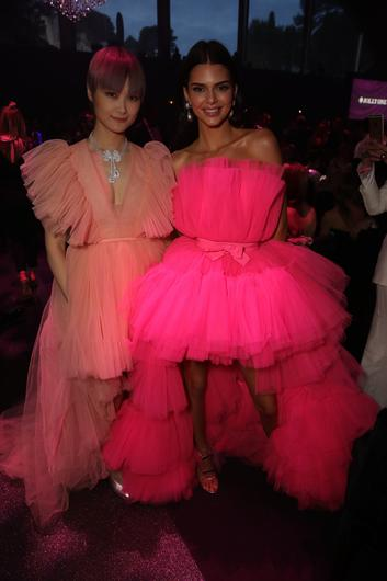 Li Yuchun and Kendall Jenner attend the amfAR Cannes Gala 2019 at Hotel du Cap-Eden-Roc on May 23, 2019 in Cap d'Antibes, France. (Photo by Andreas Rentz/amfAR/Getty Images for H&M / amfAR )