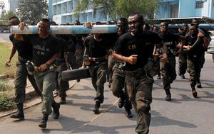 Thai police commandos take part in an anti-terrorism drill at the Crime Suppression Department headquarters in Bangkok