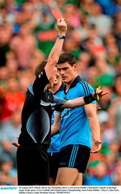 Match referee Joe McQuillan shows a red card to Dublin's Diarmuid Connolly in the final stages of the game last weekend Picture credit: Brendan Moran / SPORTSFILE